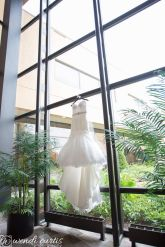 Due to a hurricane and flashflood the day of this wedding, there was no power and so I climbed up this window to make sure the bride had a picture of her dress hanging up. Courtsey of WendiCurtis Photography